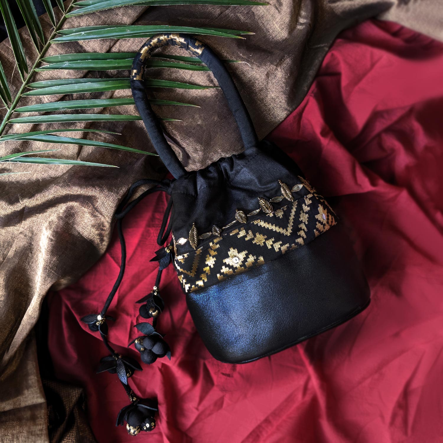 The Maya Black Leather, Brocade & Silk Cotton Potli Bag with Handwork & Tassels