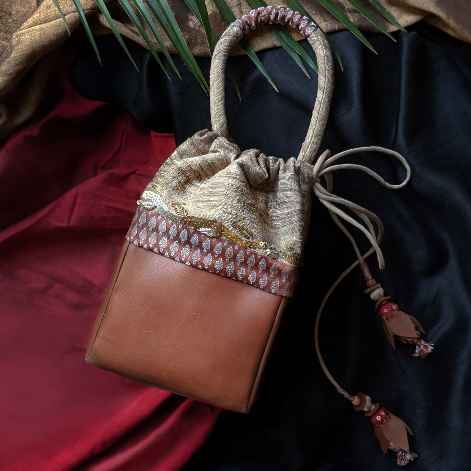 The Mohini Tan Leather, Brocade & Kosa Silk Potli Bag with Handwork & Tassels